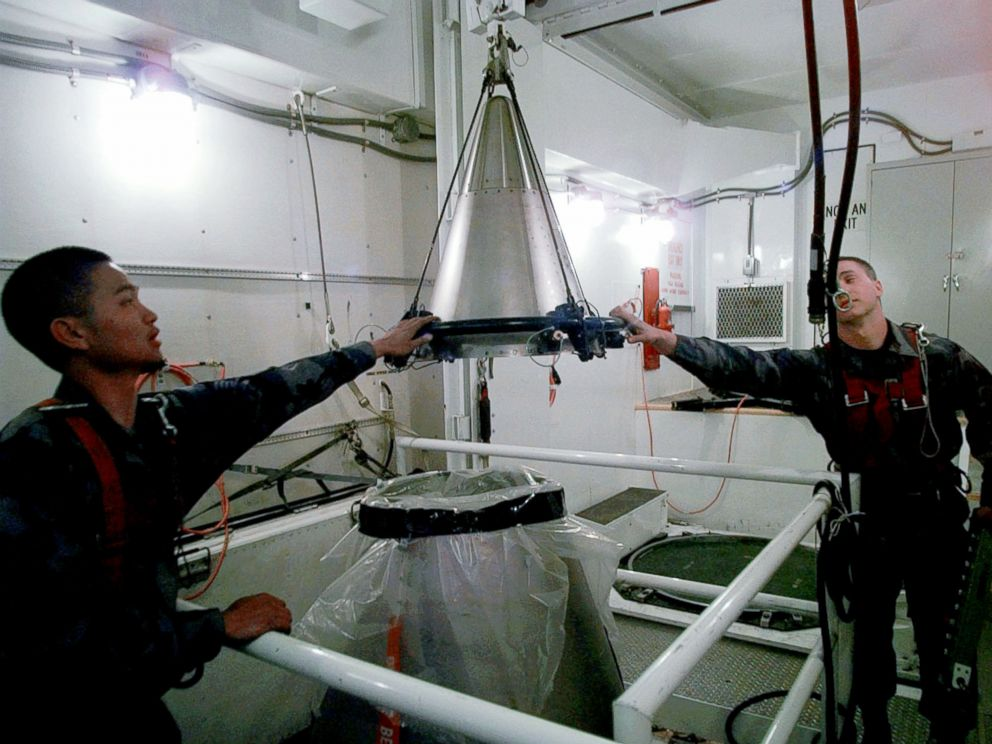 PHOTO: Senior Airmen Mark Pacis, left, and Christopher Carver mount a refurbished nuclear warhead on to the top of a Minuteman III intercontinental ballistic missile inside an underground silo in Scottsbluff, Neb., April 15, 1997.