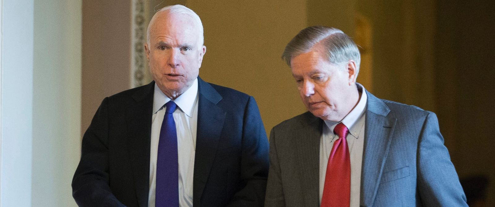PHOTO: Sen. John McCain (L) and Sen. Lindsey Graham (R) walk near the Senate chamber following Senate Republican elections on Capitol Hill in Washington, Nov. 16, 2016.