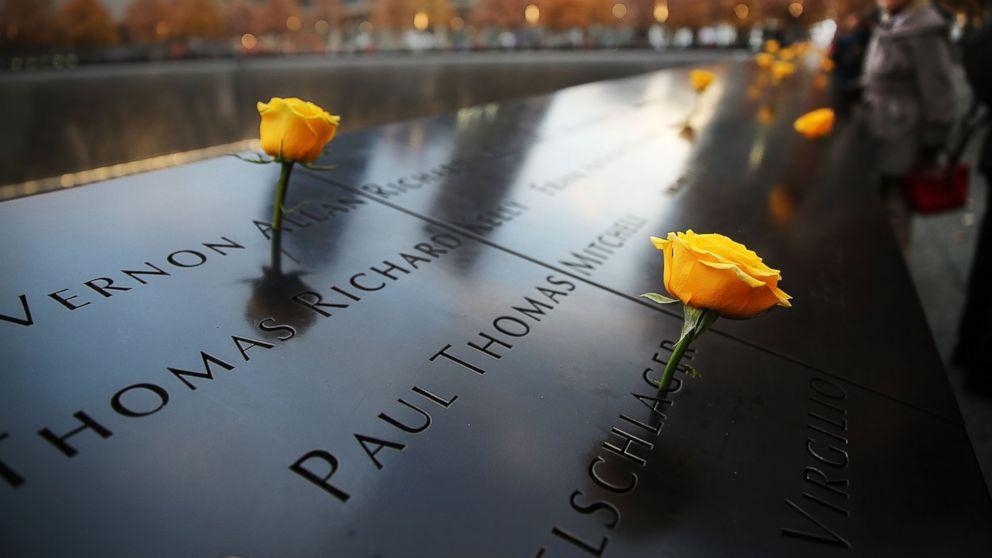 PHOTO: Flowers adorn the 9/11 Memorial for Veterans Day on Nov. 11, 2014 in New York City.