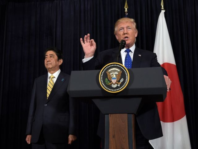 PHOTO: President Donald Trump speaks as Japanese Prime Minister Shinzo Abe listens during statements about North Korea at Mar-a-Lago in Palm Beach, Florida, Feb. 11, 2017.