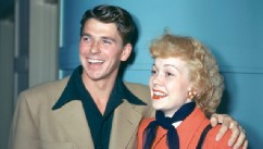 PHOTO: Ronald Reagan (1911-–2004), wearing a beige jacket with dark blue shirt with a wide collar, and his wife, Jane Wyman (1917-2007), U.S. actress, wearing a red coat with a dark blue neckscarf and black leather gloves, both smiling, circa 1945.