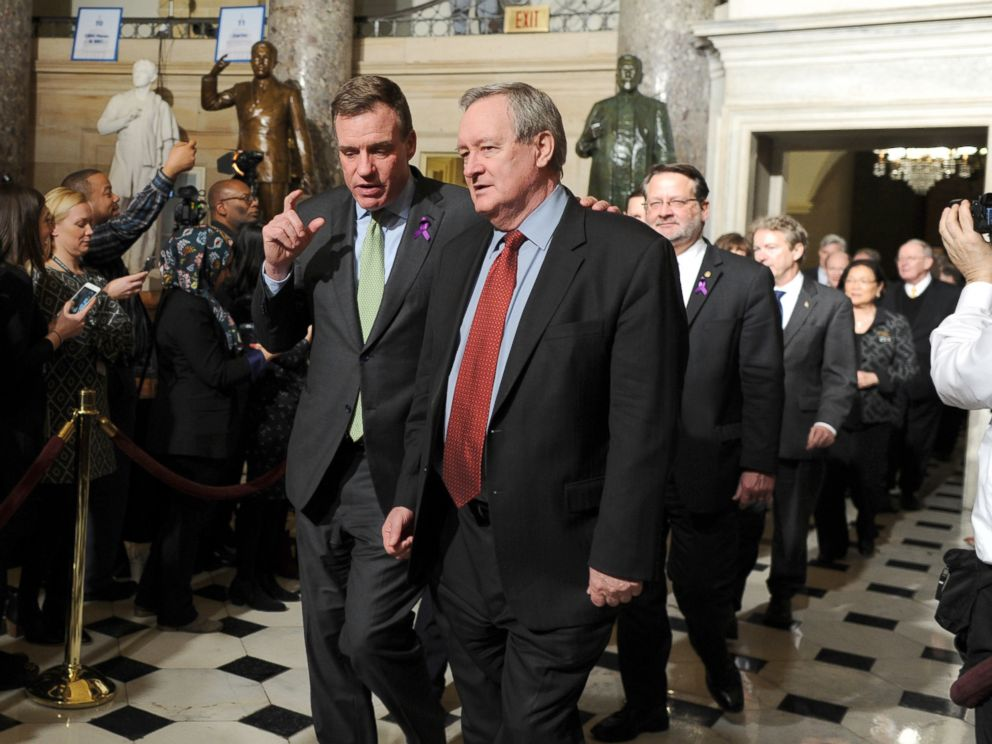 PHOTO: Senators Mark Warner (D-VA) left,, and Mike Crapo (R-ID) walk through Statuary Hall on Capitol Hill to attend President Trumps State of the Union address, Jan. 30, 2018.