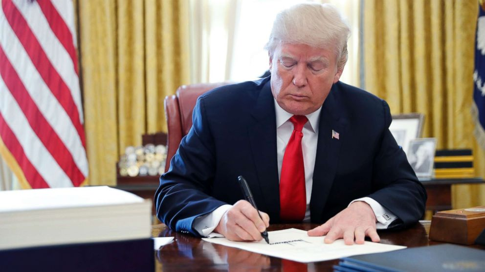 Hasil gambar untuk Before the Christmas holiday, President Trump signed the Tax Cuts Act into law