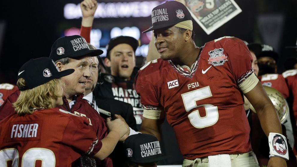 PHOTO: Florida State head coach Jimbo Fisher and Jameis Winston (5) celebrate after the NCAA BCS National Championship college football game against Auburn Monday, Jan. 6, 2014, in Pasadena, Calif. Florida State won 34-31.