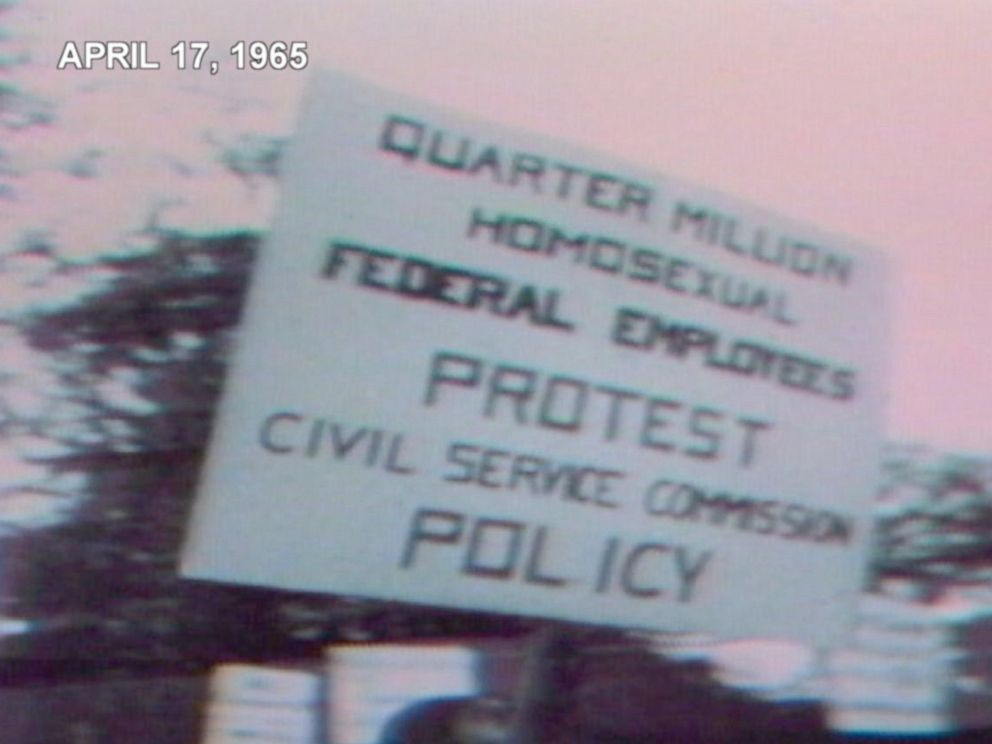 Protest sign that says that reads Quarter Million Homosexual Employees Protest Civil Service Commission Policy