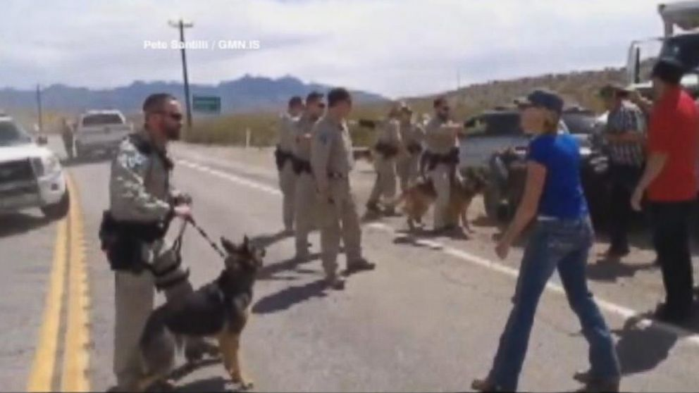 PHOTO: Federal agents clash with armed protestors over a ranchers 20-year tax fight.