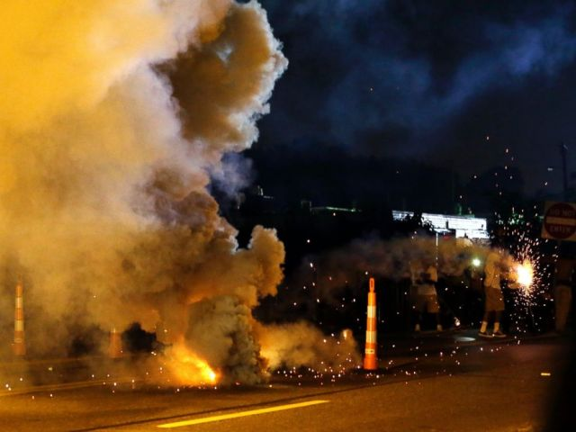 PHOTO: Tear gas is deployed after police were fired upon, Aug. 18, 2014, in Ferguson, Mo.