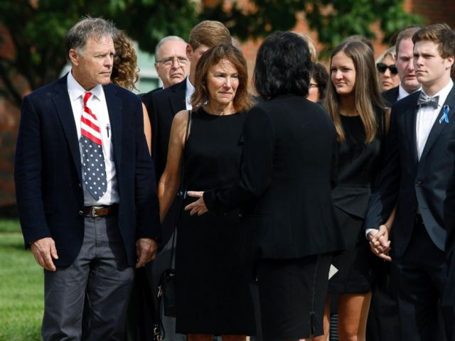 PHOTO: Fred and Cindy Warmbier, left speak with a woman after watching their son Otto Warmbiers casket carried out from his funeral at Wyoming High School on June 22, 2017 in Wyoming.