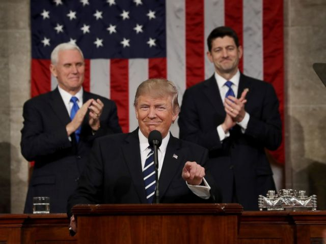 PHOTO: Vice President Mike Pence and Speaker of the House Paul Ryan applaud as President Donald Trump delivers his first address to a joint session of Congress, Feb. 28, 2017, in Washington.