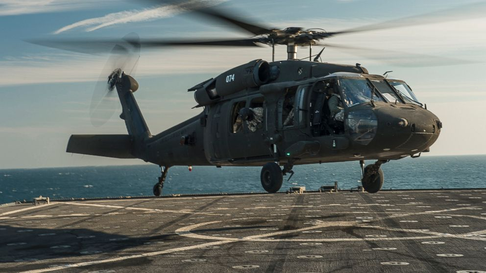 PHOTO: In this Dec. 26, 2013 file photo a U.S. Army UH-60 Blackhawk helicopter lands on the flight deck of the amphibious dock landing ship USS Harpers Ferry in the Arabian Gulf.