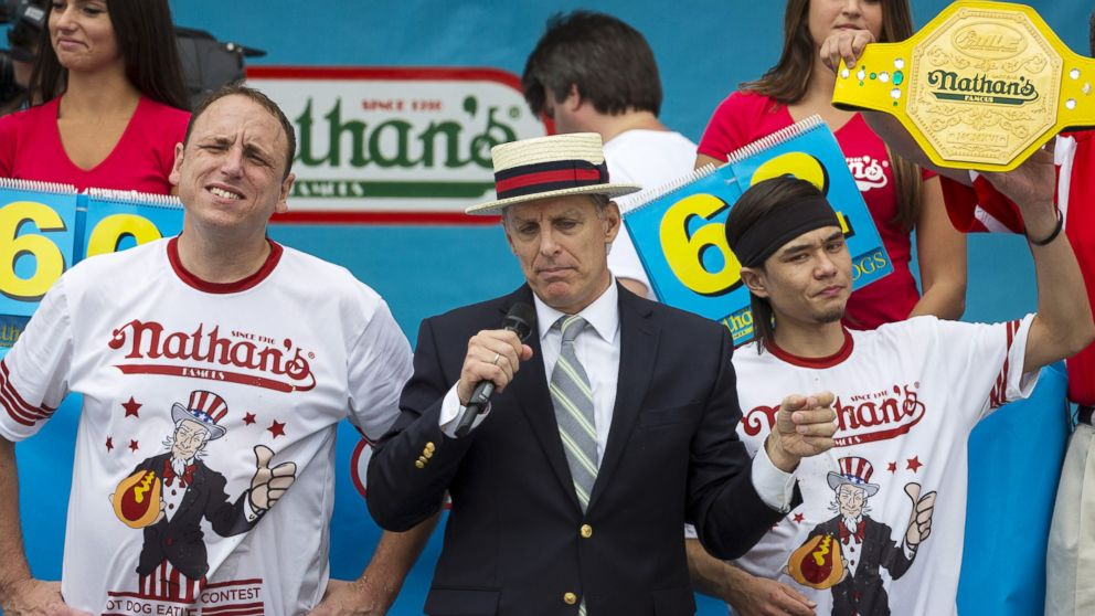 PHOTO: Matt Stonie (R) is crowned winner of the annual Fourth of July 2015 Nathans Famous Hot Dog Eating Contest in Brooklyn, New York July 4, 2015.
