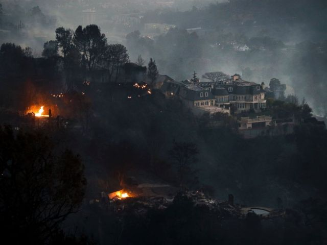 A mansion that survived a wildfire sits on a hilltop in the Bel Air district of Los Angeles Wednesday, Dec. 6, 2017.