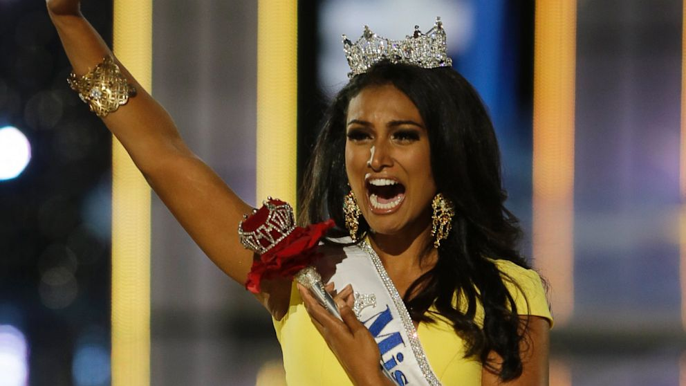 PHOTO: Miss New York Nina Davuluri walks down the runway after winning the the Miss America 2014 pageant, Sunday, Sept. 15, 2013, in Atlantic City, N.J.