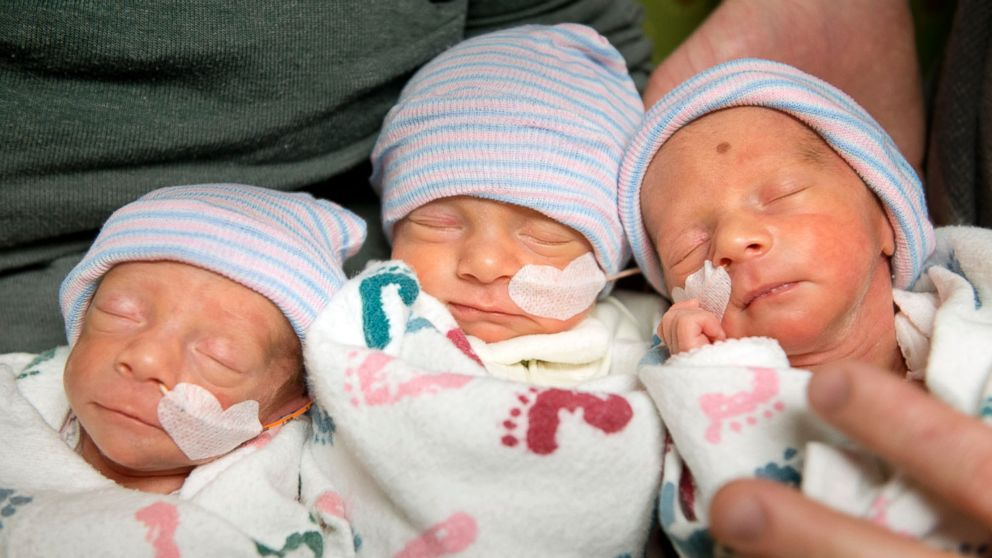 PHOTO: Hannah and Tom Hepner of Quincy, parents of identical triplets, hold, from left, Abby, Laurel and Brindabella in a self care room at Sutter Memorial on Wednesday, Dec. 4, 2013 in Sacramento, Calif.