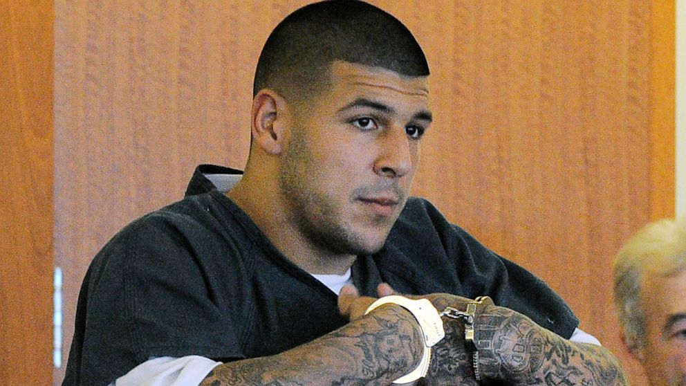 Former New England Patriots football tight end Aaron Hernandez stands during a bail hearing in Fall River Superior Court, June 27, 2013 in Fall River, Mass.