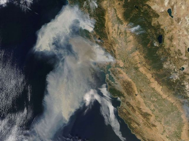 PHOTO: An image acquired by the Moderate Resolution Imaging Spectroradiometer (MODIS) instrument on NASAs Terra satellite shows smoke billowing from the fires in northern California, Oct. 9, 2017.