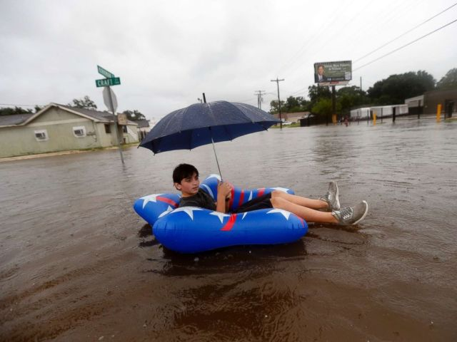 PHOTO: Julius Verret, 14, floats in street flooding in Lake Charles, La., as the city receives heavy rains from Tropical Storm Harvey, on Aug. 27, 2017.