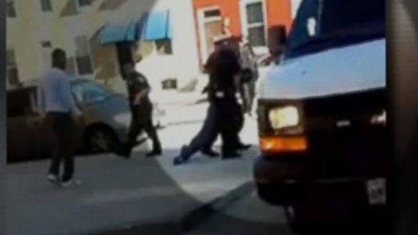 PHOTO: Cell phone video captures officers dragging Freddie Grey, 25, into a police van in Baltimore.