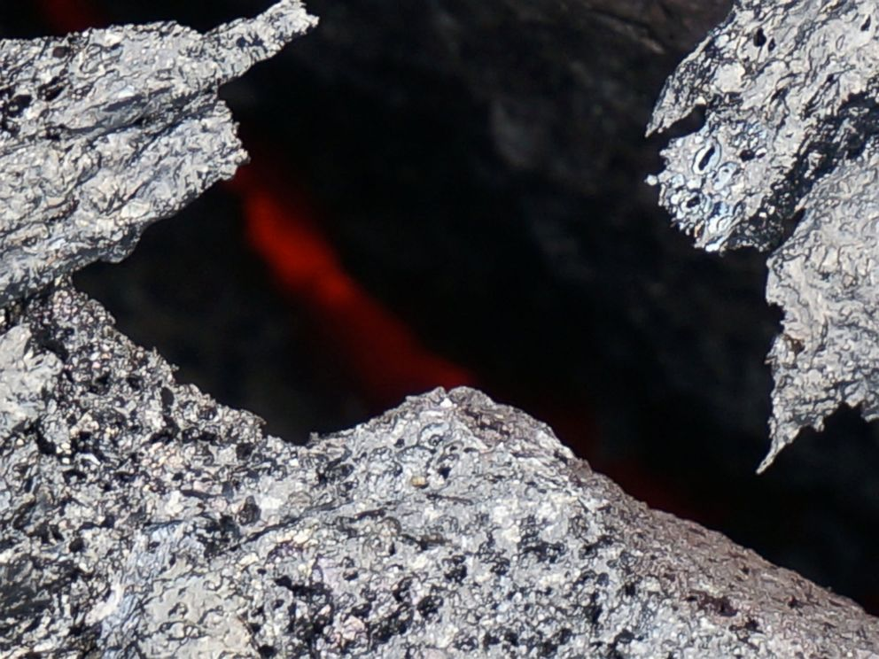 PHOTO: Molten lava can be seen in between the cracks of these rocks in Hawaii.