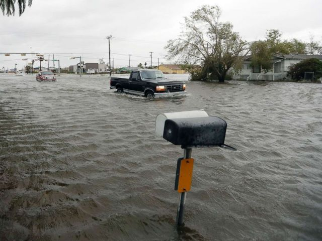 PHOTO: A vehicle moves through flood waters left behind by Hurricane Harvey, Aug. 26, 2017, in Aransas Pass, Texas.