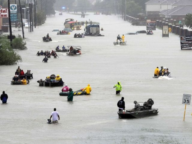 PHOTO: Rescue boats fill a flooded street at flood victims are evacuated as floodwaters from Harvey rise, Aug. 28, 2017, in Houston.
