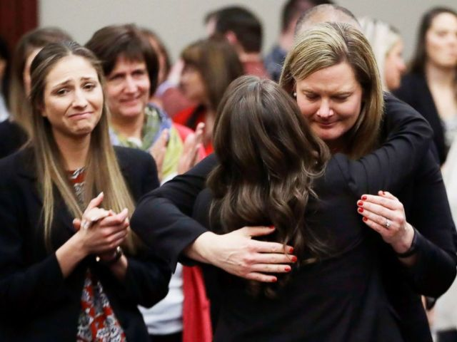 PHOTO: Victims react and hug Assistant Attorney General Angela Povilaitis after Larry Nassar was sentenced by Judge Rosemarie Aquilina to 40 to 175 years in prison, during a sentencing hearing on Jan. 24, 2018, in Lansing, Mich.