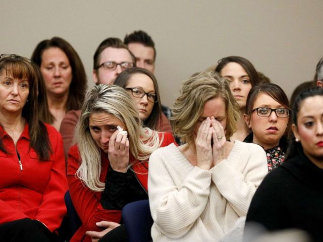 PHOTO: Victims and others look on as Rachael Denhollander speaks at the sentencing hearing for Larry Nassar in Lansing, Mich., on Jan. 24, 2018.