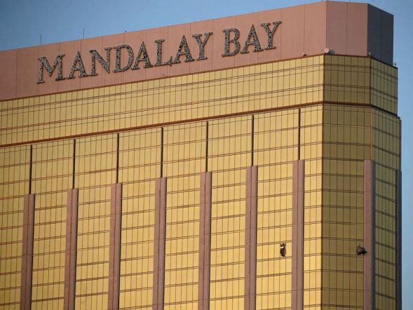 Drapes billow out of broken windows at the Mandalay Bay resort and casino, Oct. 2, 2017, on the Las Vegas Strip following a deadly shooting at a music festival in Las Vegas.