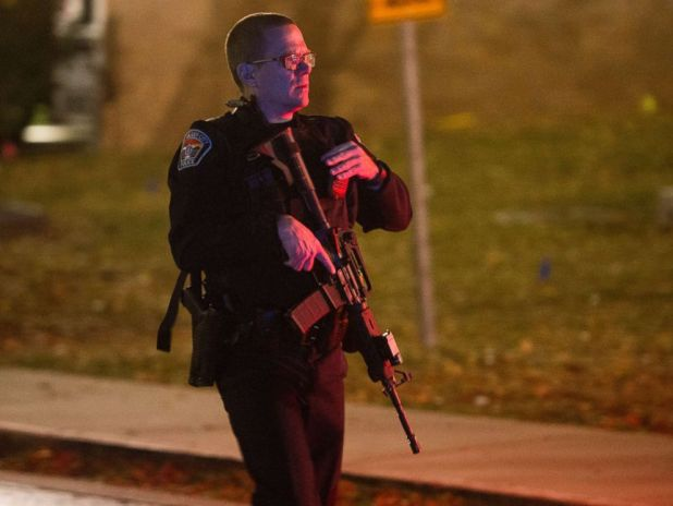 PHOTO: A police officer searches for a gunman near the University of Utah campus in Salt Lake City, Oct. 30, 2017. Police say a deadly shooting occurred near the school campus on Monday.