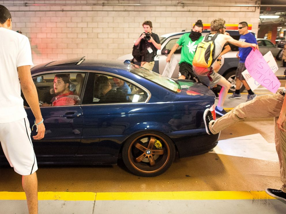 PHOTO: Protesters against Republican presidential candidate Donald Trump kick and jump on a car leaving a Trump campaign rally on Thursday, June 2, 2016, in San Jose, Calif.