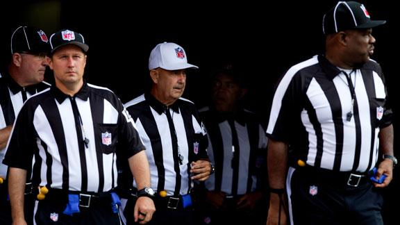Referee trips Cowboy wide receiver with hat