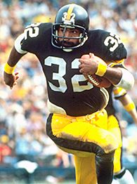 Franco Harris correndo.