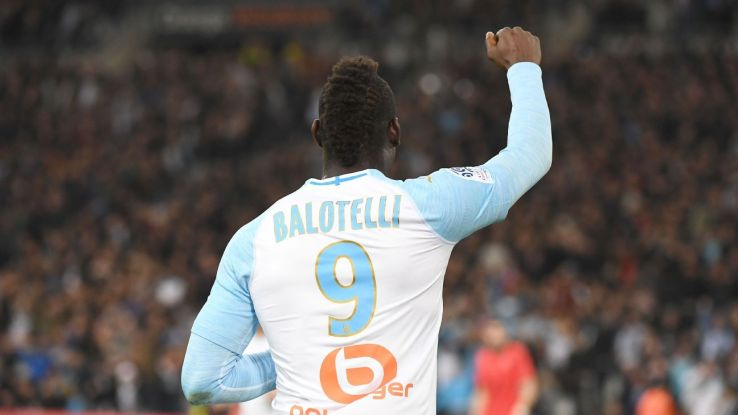 Marseille's Mario Balotelli celebrates after scoring a goal in a win against his former club Nice.