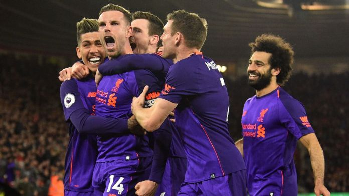 Jordan Henderson and his Liverpool teammates celebrate during their Premier League win at Southampton.
