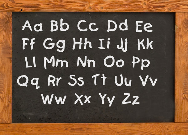 Alphabet on the old style blac: Sample of writnig on the school board