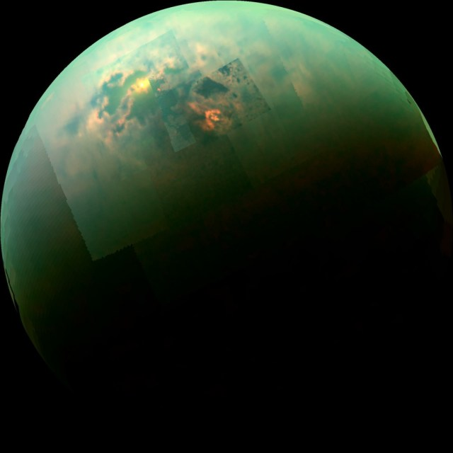 "This near-infrared, color mosaic from NASA's Cassini spacecraft shows the sun glinting off of Titan's north polar seas. The sunglint, also called a specular reflection, is the bright area near the 11 o'clock position at upper left. This mirror-like reflection, known as the specular point, is in the south of Titan's largest sea, Kraken Mare, just north of an island archipelago separating two parts of the sea. The view was acquired during Cassini's August 21, 2014 flyby of Titan, also referred to as ""T104"" by the Cassini team."