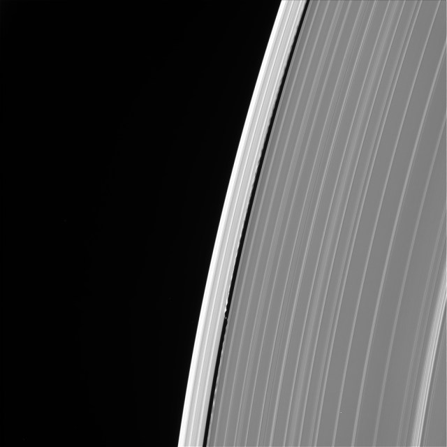 This image of Saturn's outer A ring features the small moon Daphnis and the waves it raises in the edges of the Keeler Gap. The image was taken by NASA's Cassini spacecraft on Sept. 13, 2017. It is among the last images Cassini sent back to Earth.