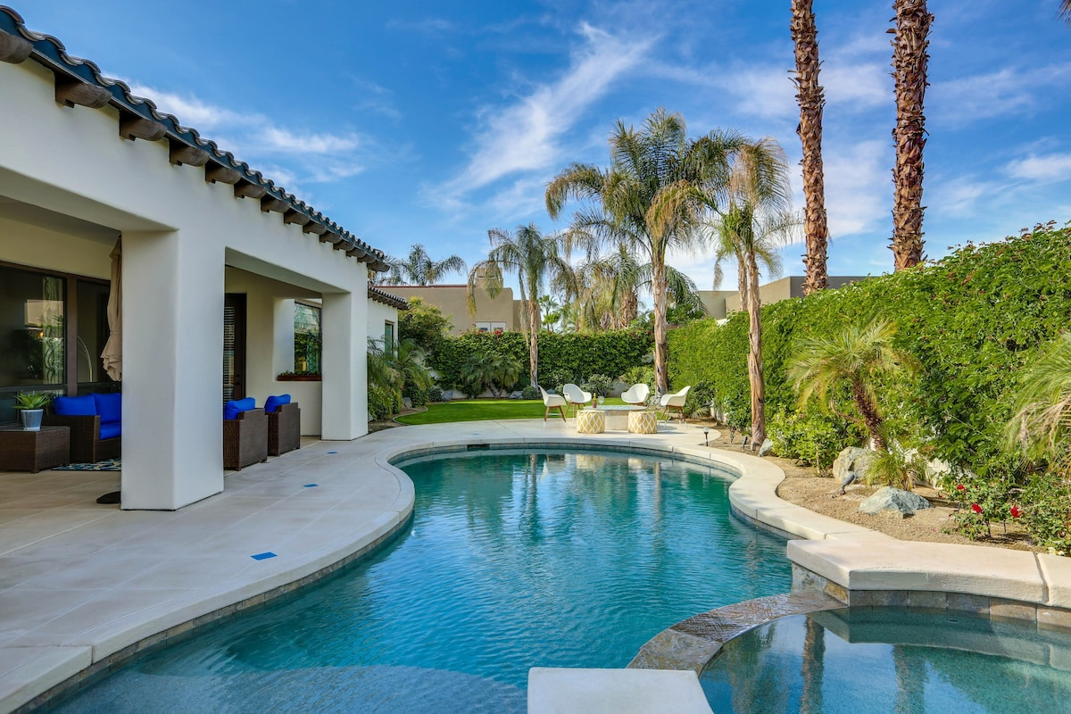 Palm Trees and lush landscaping surround this beautiful pool