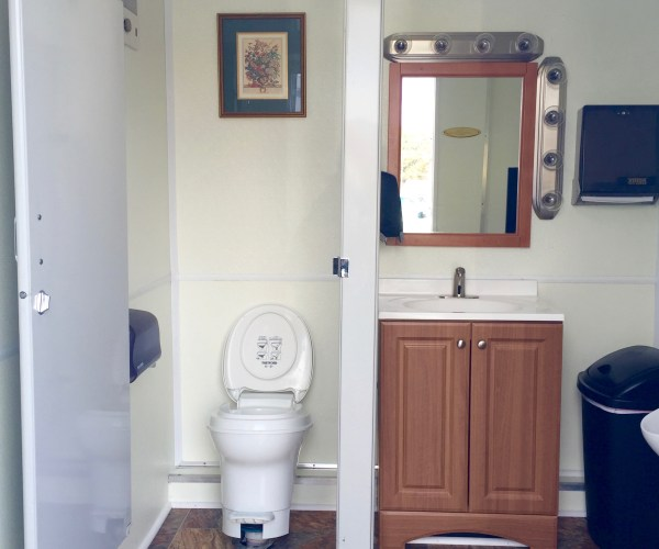 Medium Restroom Trailer Rentals DE - male inside 1