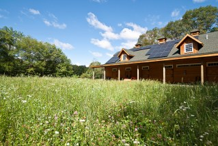 The barn located on site with pv panels on south facing roo