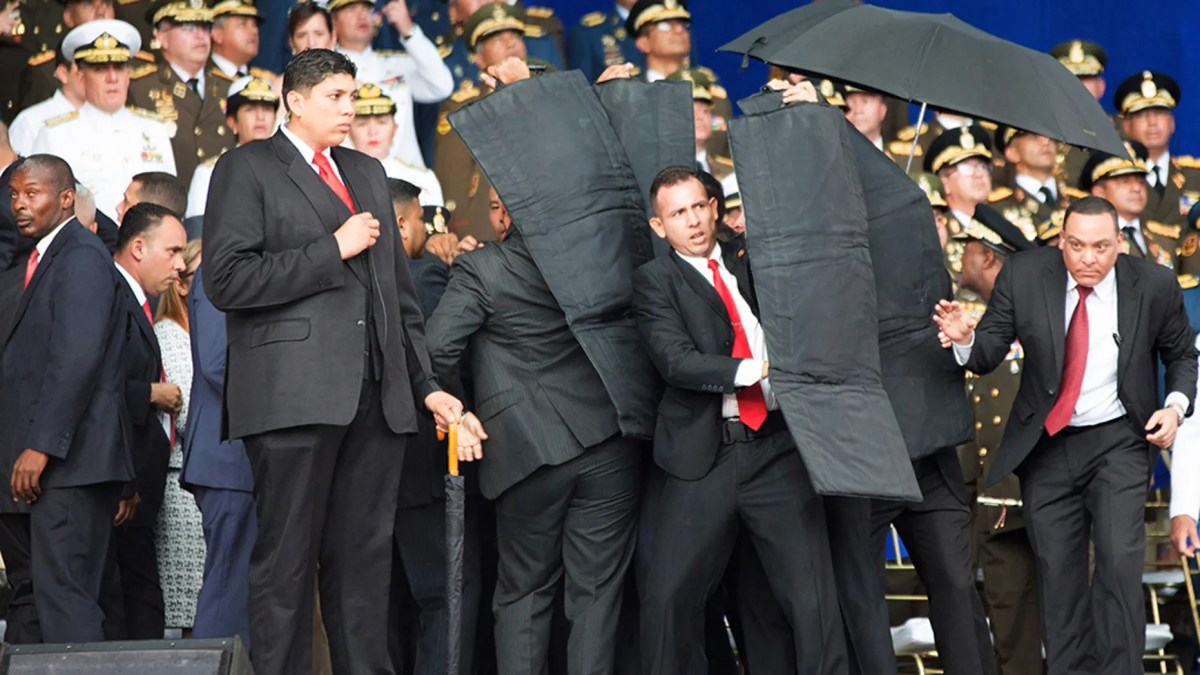 Security personnel surround President Nicolas Maduro following an alleged assassination attempt in August.