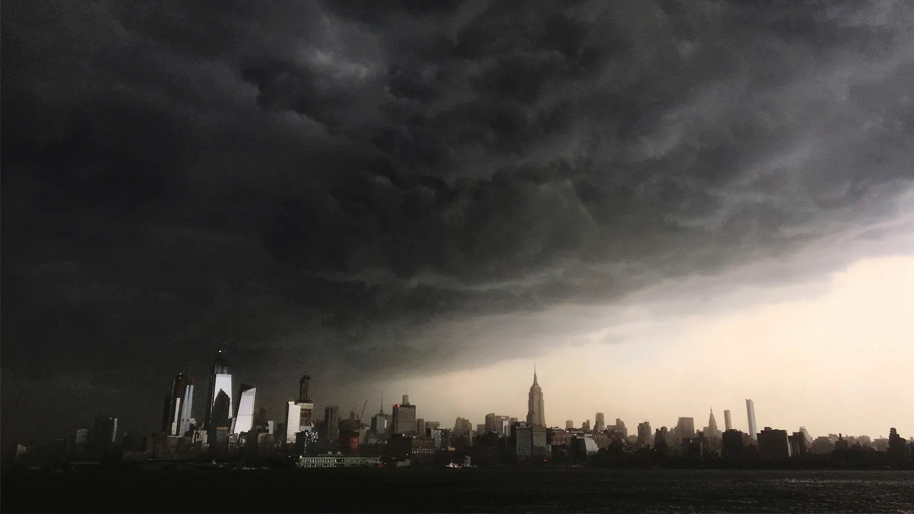 File photo:Storm clouds seen gathering over New York City on May 15, 2018.