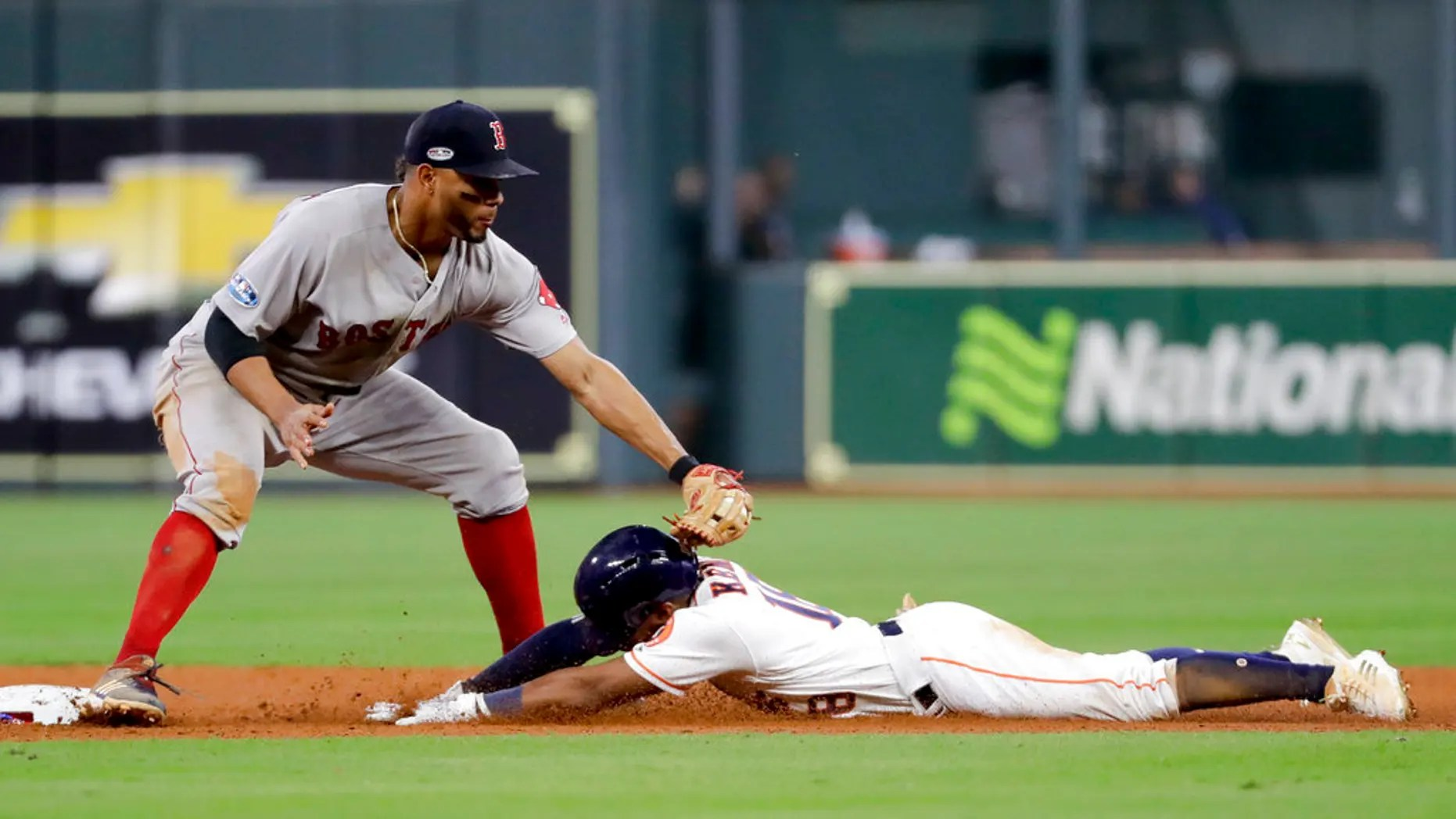 FILE: Houston Astros' Tony Kemp is tagged out at second by Boston Red Sox shortstop Xander Bogaerts during the eighth inning in Game 4 of a baseball American League Championship Series.