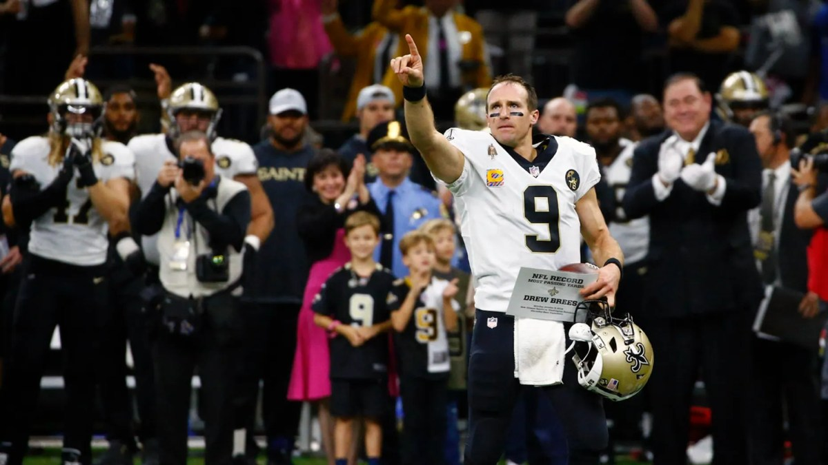 New Orleans Saints quarterback Drew Brees (9) responds to the crowd after breaking the NFL all-time passing yards record in the first half of an NFL football game against the Washington Redskins in New Orleans, Monday, Oct. 8, 2018. (AP Photo/Butch Dill)