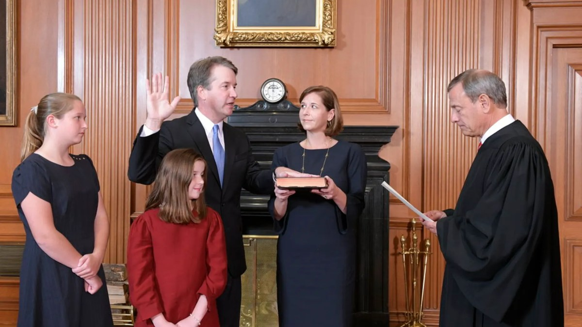 Chief Justice John Roberts, right, administers the Constitutional Oath to Judge Brett Kavanaugh in the Justices' Conference Room of the Supreme Court Building. (Fred Schilling/Collection of the Supreme Court of the United States via AP)