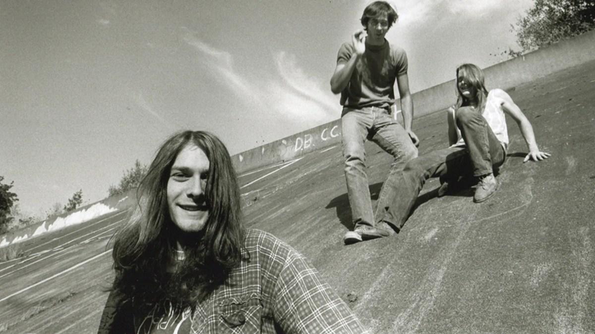 Group portrait of American grunge band Nirvana in Seattle, circa 1990. L-R Kurt Cobain, Krist Novoselic, Chad Channing.