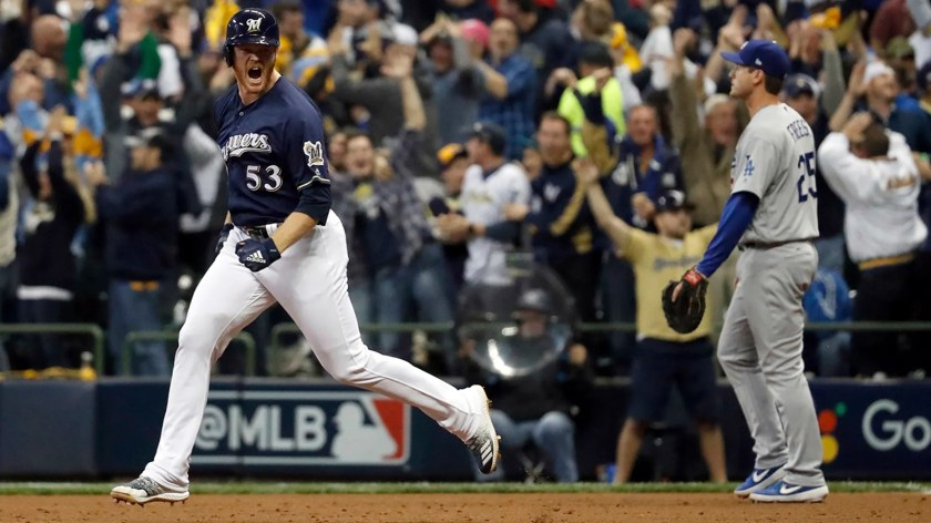 Milwaukee Brewers' Brandon Woodruff (53) celebrates after hitting a home run during the third inning of Game 1 of the National League Championship Series baseball game against the Los Angeles Dodgers Friday, Oct. 12, 2018, in Milwaukee.