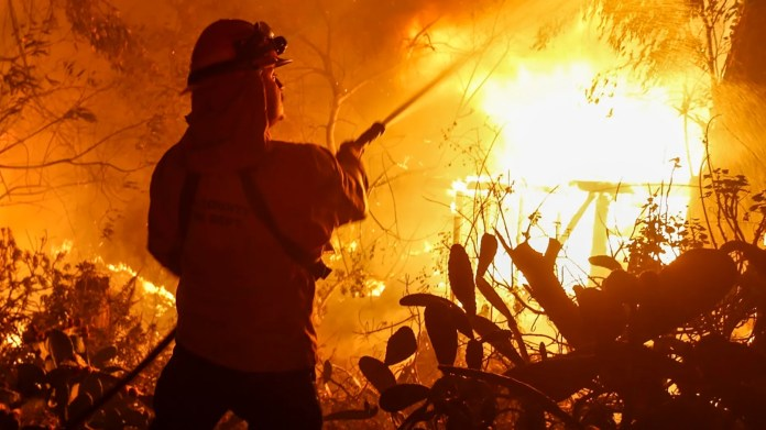 A firefighter battles the Woolsey Fire in Malibu, Calif., last November.