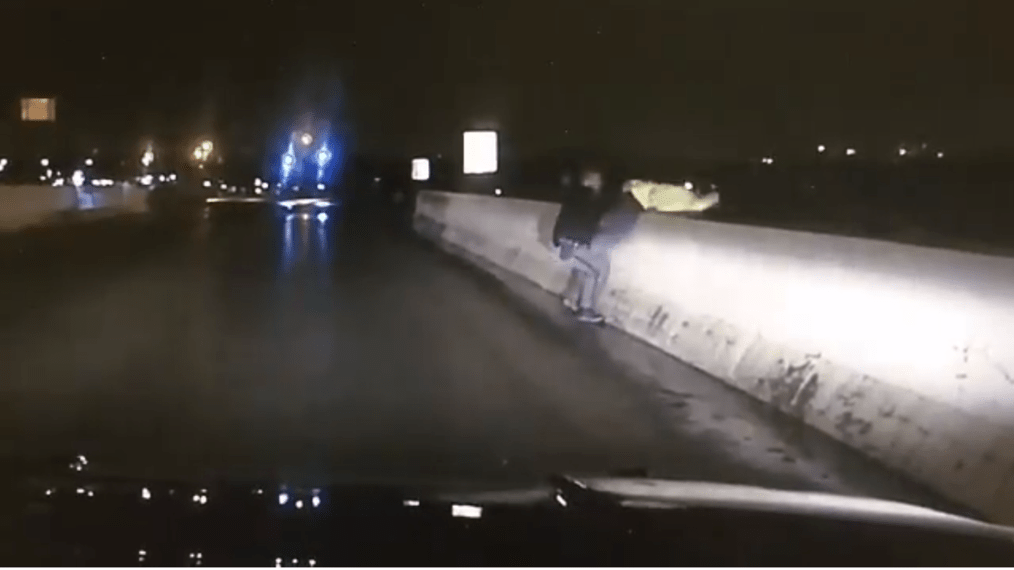 Franklin County Sheriff's Deputy William Ball was captured rescuing a suicidal man by pulling him back from the overpass.