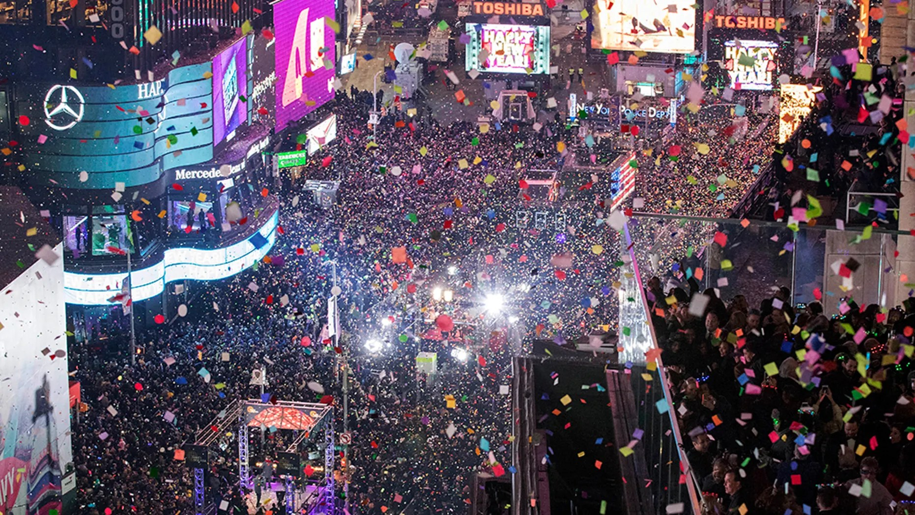 In this Jan. 1, 2017 file photo, revelers celebrate the new year as confetti flies over New York's Times Square. (AP Photo/Mary Altaffer, File)